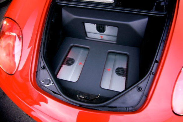 Focal FPS amplifiers installed in the trunk, clean install with a leather finish.