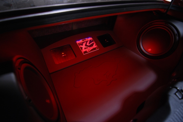 Red lighting and the embossed mustang add a nice touch to this bold finish.