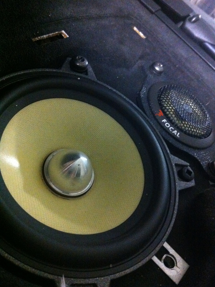 Rear speakers with the factory grill off. Looks like OEM.