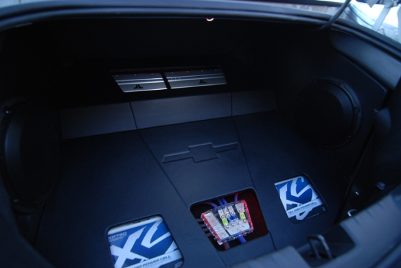 Two JL 10W3v3 subwoofers installed on the sides. custom panel made with the chevy logo.
