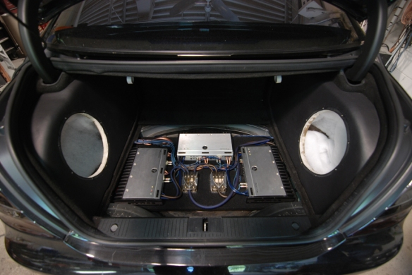 JL Audio slash series amplifiers running all speakers in the car including the subwoofers that we just put in.