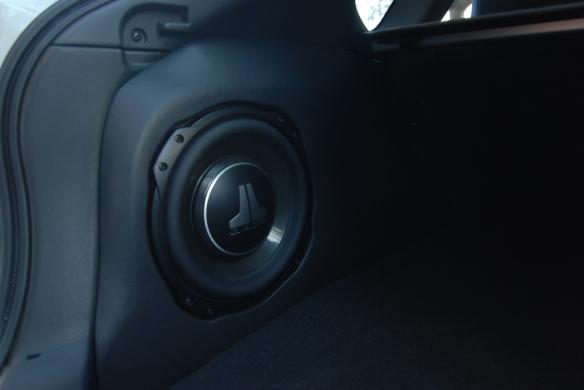 JL audio 10TW3 fits nice and sounds amazing.