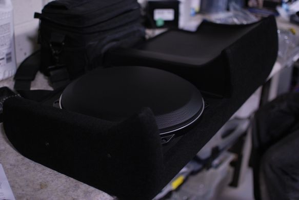 "JL Audio 13"" TW5 subwoofer installed under the rear seat in addition to the Sony 8"" subwoofer under the passenger side rear seat."