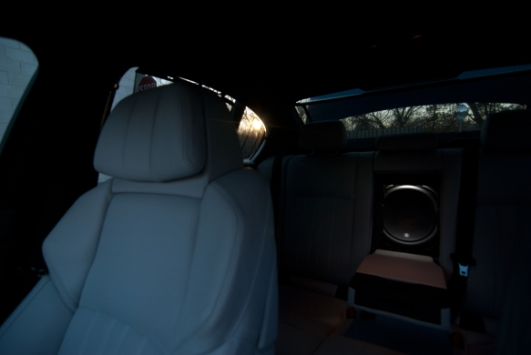JL Audio W6 subwoofer visible through subwoofer