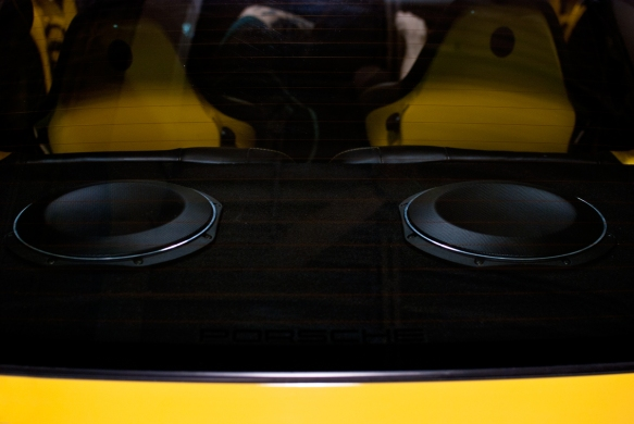 Two JL audio 10TW1 subwoofers installed behind rear seats