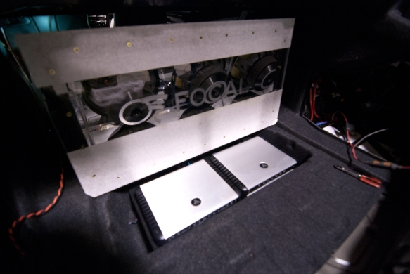 JL Audio HD amplifiers hidden in the floor storage compartment. Helix DSP Pro used for the sound calibration.